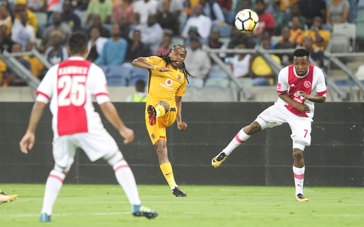 Thabo Mosadi of Ajax Cape Town F.C. watches as Siphiwe Tshabalala of Kaizer Chiefs FC fires the ball in towards the goals during the Absa Premiership 2017/18 game between Kaizer Chiefs and Ajax Cape Town at Moses Mabhida Stadium, Durban on 16 December 2017.