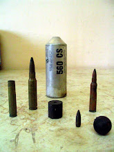 """Photo: live ammunition, """"rubber coated' steel bullets (sliced to eject steel upon impact--and more often than not aimed at eyes and face),  and bombs used against peaceful Palestinian, Israeli and international protesters at Bil'in, where the Israeli Apartheid Wall cuts off Palestinians from their land, trees, livelihoods"""