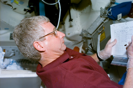 SWUIS,Mission Specialist Hawley works with the experiment