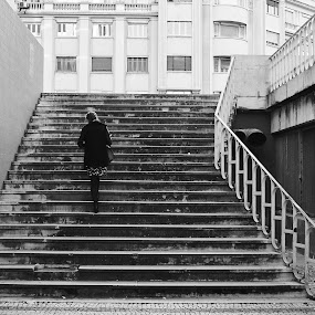 going home by Paulo Rodrigues - People Street & Candids ( arquitectura, bairro azul, building, b&w, konika28mm, art, street, architecture, capture one, people, fachadas, city, photo/foto, urban, cidade, people/pessoas, pattern, sonya6000, local, portugal, lisboa )