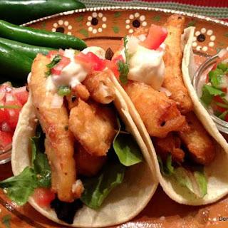 Fish Tacos with Pico de Gallo and White Sauce.
