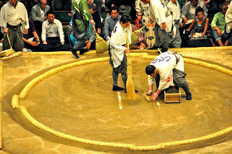 Photo: Between the fights the sweep the ring and sometimes remove some of the (sacred) clay.