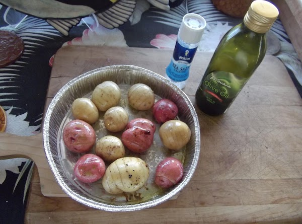 While roast is cooking, prepare little potatoes for roasting.  (*Make slices in fingerling...