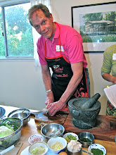 Photo: Lee chopping ingredients for the chilli paste