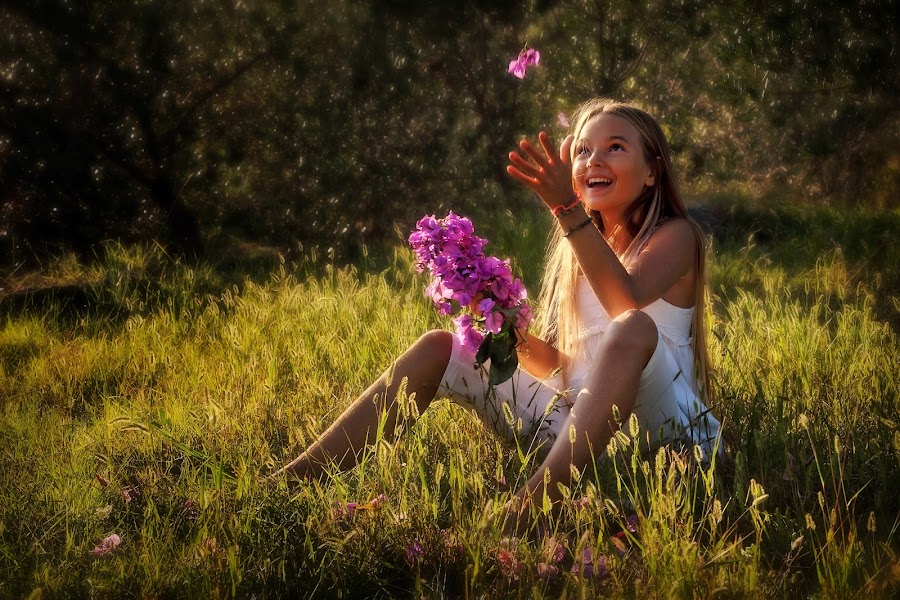 Playful by Andrija Vrcan - Babies & Children Child Portraits ( playful, girl, grass, children, pink, sunlight, breast cancer awareness, lighting, lights, mood factory, hot pink, mood, scents, color, mood-lites, sassy, brighten our world,  )