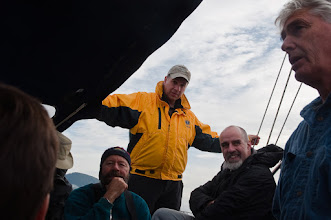 Photo: Mike, Steve, Mike(2), and Tom in cockpit of the Ocean Light II; steaming toward our first bear stakeout