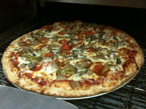 Photo: My FaV! Pepperonis,  House Cooked Italian sausage with fennel, & Sweet peppers.  When you order toppings at Pinos Pizza you get TOPPINGS at Pinos Pizza.