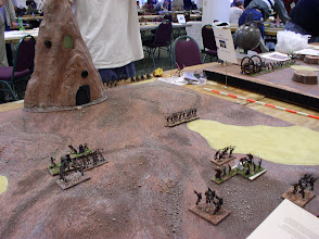 Photo: Scenario 2: Rescue on Geonosis - The stronghold is the Geonosian Hive City.  Jedi Masters fight Geonosian Warriors on the left, Jedi Padawan fight Geonosians on the right.