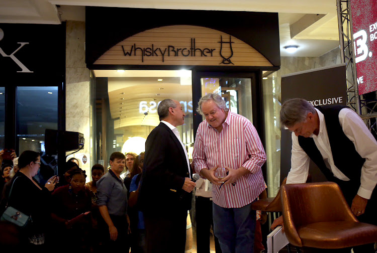 Author Jacques Pauw (in striped shirt) prior to the official launch of his book The President's Keepers at Exclusive Books in Hyde Park, Johannesburg.