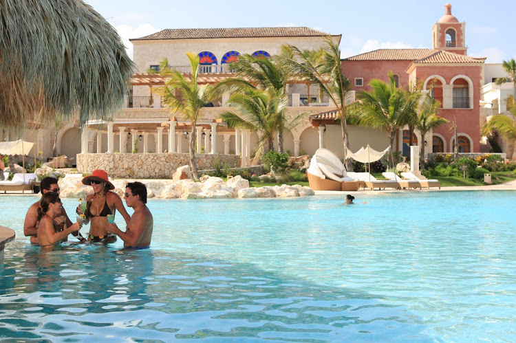 Couples drinking in the main pool of Sanctuary Cap Cana (click to enlarge).