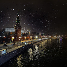 Moscow at night by Dmitry Sviridov - City,  Street & Park  Night ( sky, city, reflections, cold light, warm light, night, kremlin, church, moscow, winter, historical, transport, water, boat, street light, stop, light, road, car, snow, transport stop, dark, perspective )