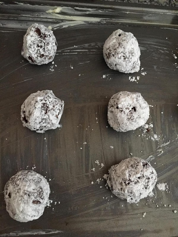 make balls out of cookie dough about an inch wide. Roll in powdered sugar,and...