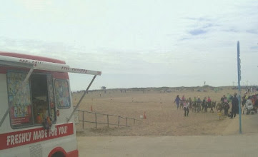 Photo: Nuttals donkey troupe in the background, with an ice-cream van providing utility. The sands pretty full of folks in the afternoon.