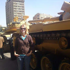 Woman in Egypt next to tank during the Egyptian Revolution of 2011 | Krys Kolumbus Travel