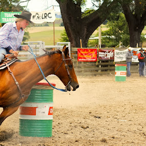 Tight Turn by Russell Benington - People Professional People ( rider, barrel racing, arena, horse, rodeo, competition )