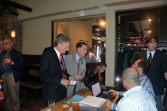 Photo: John Scrivens & Gabriel Laszlo at the check-in desk