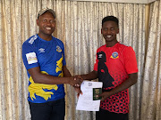 Masibusane Zongo (R) pose for a photograph with a Tshakhuma Tsha Madzivhandila FC official after he signed for the GladAfrica Championship.