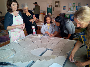 Photo: Saturday, July 20, 2013 Hidden Garden Steps ceramic-tile mosaic preview at St. John of God community hall in San Francisco's Inner Sunset District: Hidden Garden Steps project artists Aileen Barr (left) and Colette Crutcher (right) working next to donors who are adding their names to a ceramic-tile element-in-progress for the 148-step mosaic that will be installed on 16th Avenue, between Kirkham and Lawton streets in San Francisco. For more information about the Hidden Garden Steps project, please visit http://hiddengardensteps.org.