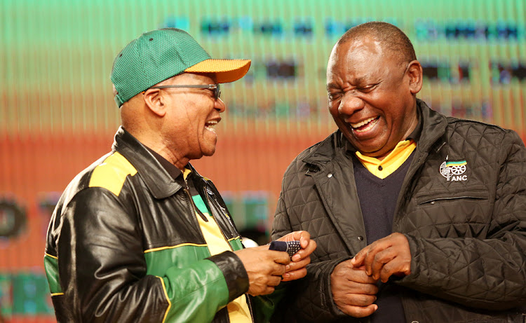 ANC President Jacob Zuma and his deputy Cyril Ramaphosa share a light moment before the start of the ANC Policy conference taking place at Nasrec.
