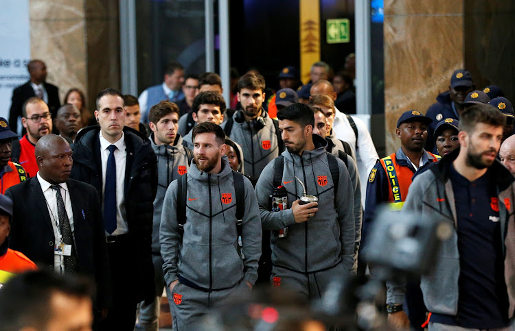 Barcelona's Argentine soccer star Lionel Messi arrives with teammates for the Nelson Mandela Centenary Challenge against South Africa's Mamelodi Sundowns at the FNB Stadium, in Johannesburg, South Africa, May 16, 2018.