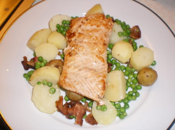 Rinse your salmon fillets with water and pat dry. Now place them flat in...