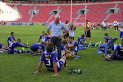 Stormers coach Robbie Fleck peps up his team.