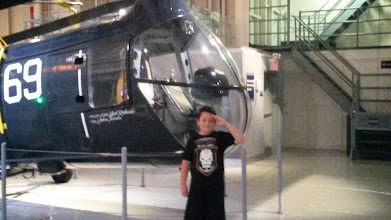 Photo: Ethan, saluting in the museum area inside the ship