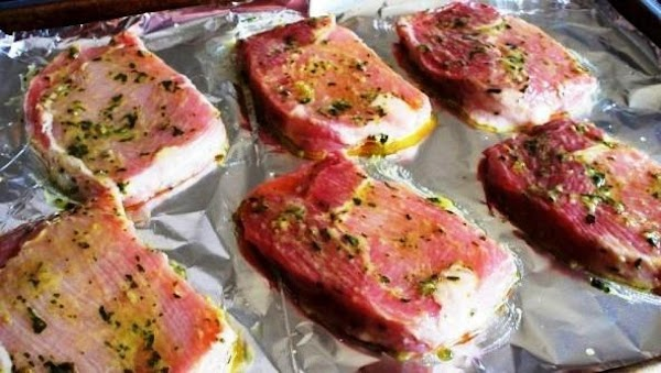 Drain chops, discarding marinade. Place chops on rack in broiler pan so the chops...