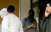 Frahad Hoomer, the alleged mastermind in the Islamic State loyalists case, donned a black balaclava to hide his face inside the Verulam Magistrate's court on Monday.