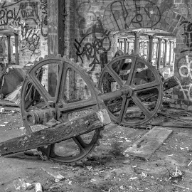 Wheels by Ella Kingston - Black & White Buildings & Architecture ( decaying building, derelict building, abandoned building, workshop, abandoned machinery, black and white,  )