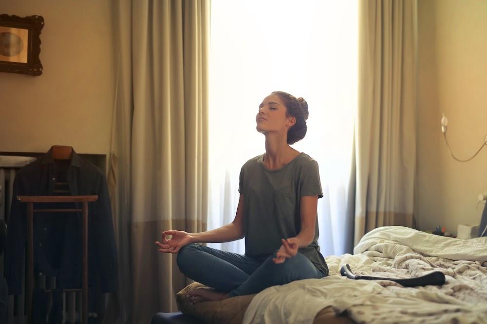 woman-meditating-in-bedroom-3772612