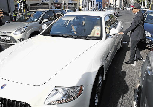 THE DRINKER, HIS DRIVER AND THE MASERATI: ANC NEC member Tony Yengeni leaves the Cape Town Magistrate's Court yesterday