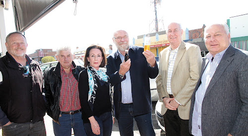 Narrabri Chamber of Commerce president Russell Stewart, left, deputy president Ian Duffey, Sustainable Clean Energy strategy director Phillipa Lehmann, managing director, Alastair Brodie,  director Warwick Newell and Waste Stream Solutions director Hans Felden with a sample of fuel produced from waste.