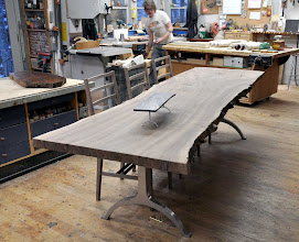 Photo: http://dorsetcustomfurniture.blogspot.com/2010/04/walnut-slab-table-is-done.html