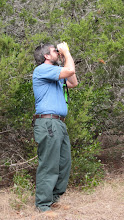 Photo: Paul tests out my new laser rangefinder for a more accurate height measurement.