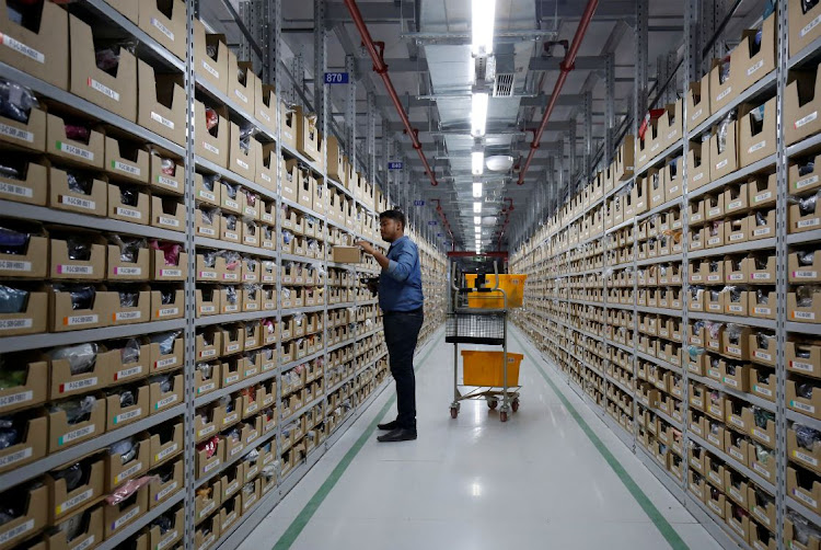 An employee at an Amazon fulfilment centre on the outskirts of Bengaluru, India. Picture REUTERS/ABHISHEK N CHINNAPPA