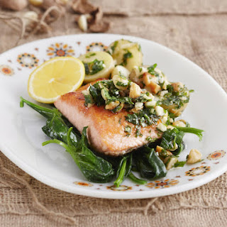 Trout with Macadamia Herb Pesto served with Steamed Potaoes and Spinach.