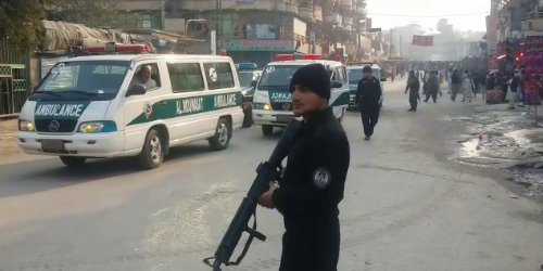 Six people including a woman and a child have been killed and 13 more injured when a suicide bomber drove a motorcycle into a crowd at a political rally in Jalalabad.