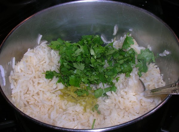 When the rice is done cooking, stir well. Add the lime zest, juice and...