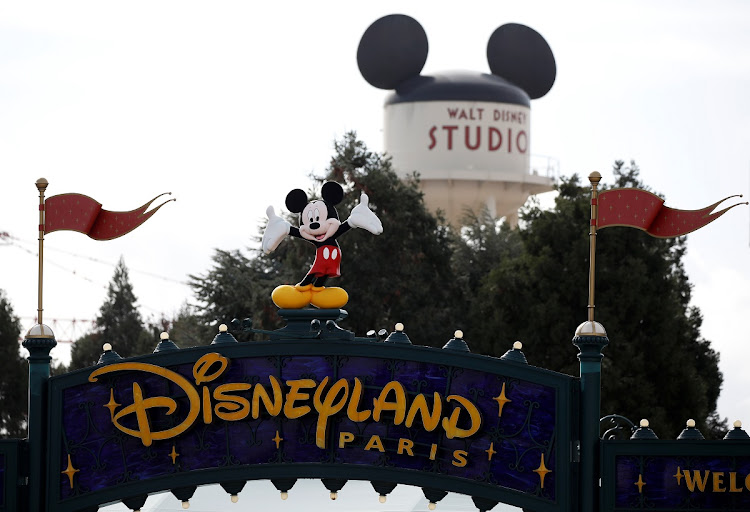 Disney character Mickey Mouse is seen above the entrance of Disneyland Paris, in Marne-la-Vallee, near Paris, France, March 9 2020, where a maintenance worker was tested positive for coronavirus over the weekend.