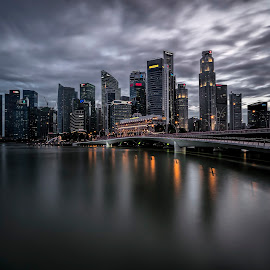 The Solemn Skyline by Gordon Koh - City,  Street & Park  Skylines ( clouds, shenton way, skyline, reflection, cityscape, singapore, city, cbd, skyscraper, vista, asia, long exposure, jubilee bridge, waterfront )