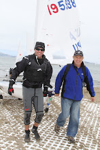 Photo: Jeff welcomes Jerry's help to pull his boat across the beach.