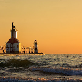Golden Twilight by Betty Arnold - Landscapes Sunsets & Sunrises ( michigan lighthouses, lake michigan lighthouses, sunset, great lakes lighthouses, lighthouse, seascape, st. joseph lighthouse,  )