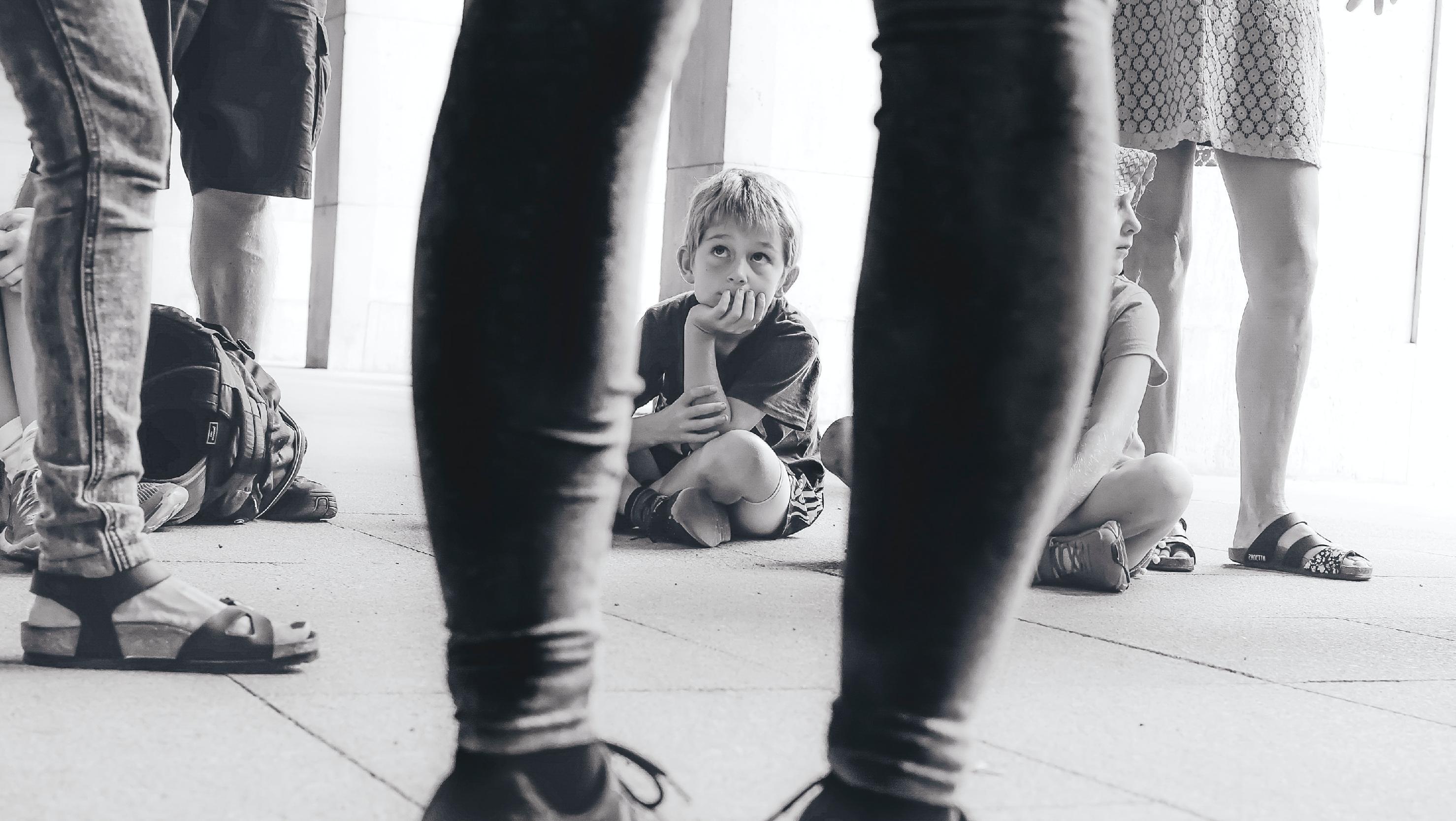 sitting kid amongst legs