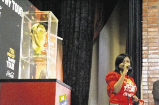 CUP FRENZY: The world's finest soccer prize is displayed at its final destination in Dlamini, Soweto, on Friday.Pic. Mohau Mofokeng. 04/06/2010. © Sowetan.