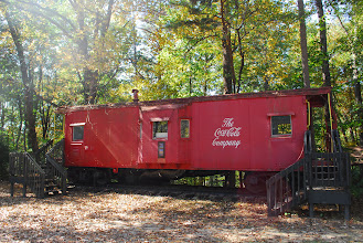 Photo: The Caboose was a donation from the Southern Railway in recognition of the camp's historical ties to the railroad.  In the 1980's, the Coca-Cola Foundation funded the restoration of the Caboose, which currently serves primarily as a library.