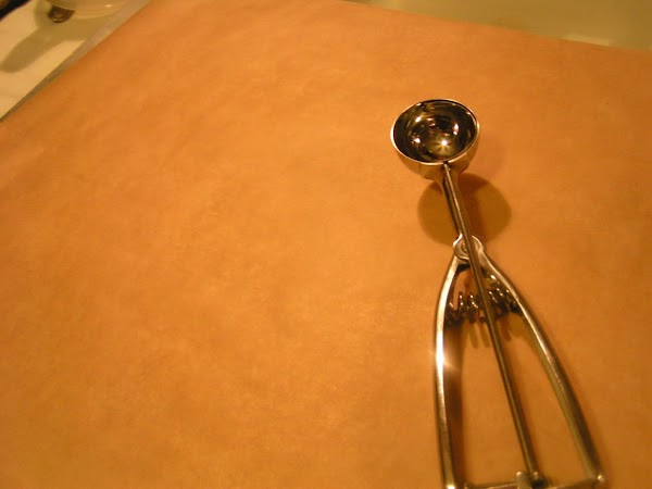 Line cookie sheets with parchment paper.