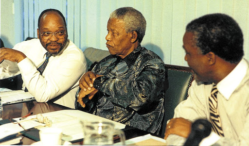 Nelson Mandela is flanked by Jacob Zuma and Thabo Mbeki. The writer says Zuma played a significant role during the multiparty negotiations for a new dispensation.