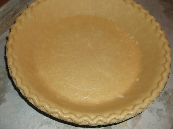 Preheat oven to 350 degrees Fahrenheit and place unbaked crust (in pie pan) on...