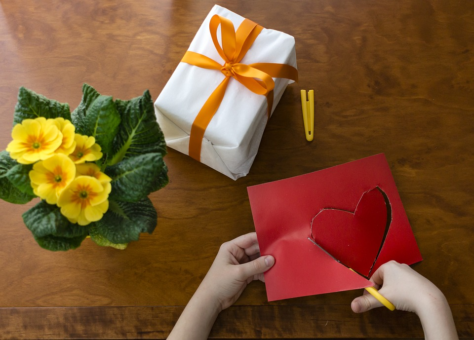 mother's day gift ideas - cutting out a red heart from card